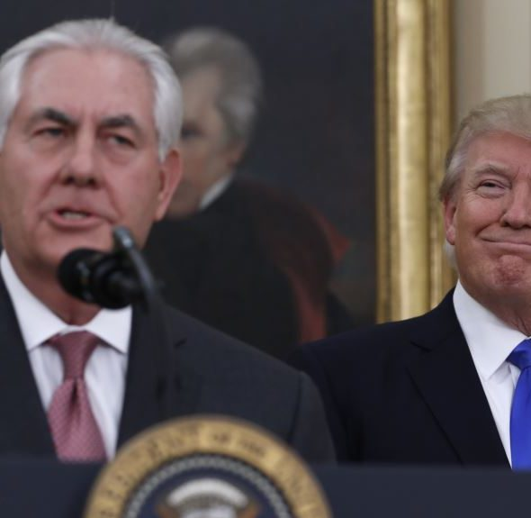 President Donald Trump looks to Secretary of State Rex Tillerson after he was sworn in in the Oval Office of the White House in Washington, Wednesday, Feb. 1, 2017. (AP Photo/Carolyn Kaster)